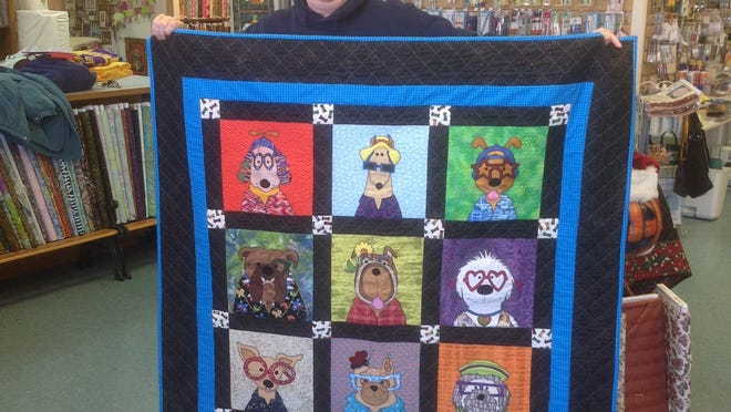 "Mary Spilman (from left) was the winner of the ""Dog Heads"" quilt."