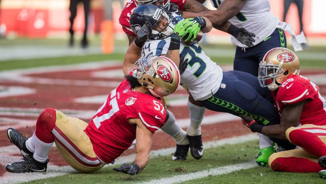 Seattle Seahawks running back Thomas Rawls rushes for a touchdown against San Francisco in the second quarter Sunday. Rawls had just 14 yards on eight carries.