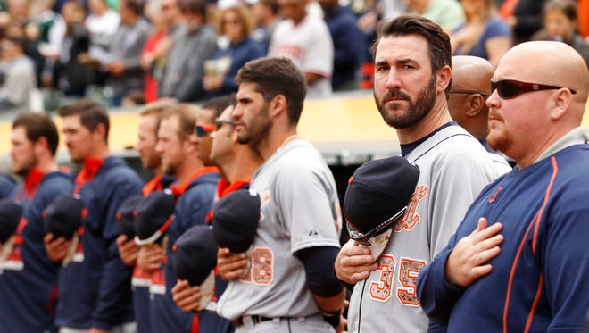 Tigers pitcher Justin Verlander stands on the field during the singing of the national anthem before the start of the game against the Oakland Athletics at O.co Coliseum on Monday.