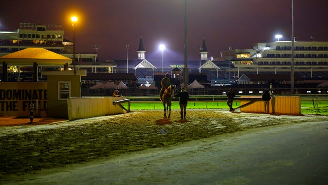 A horse is brought back to the stable areas at Churchill Downs.