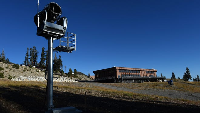 An automated snow making machine is seen at the base of the Mt. Rose Ski Area near Reno on Oct. 6, 2015. Resort operators are waiting for cold weather needed to cover the slopes.