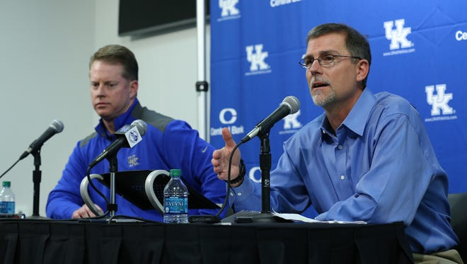 New coaches Darin Hinshaw, left, and Eddie Gran, right, are introduced at UK at a press conference.January 4, 2016