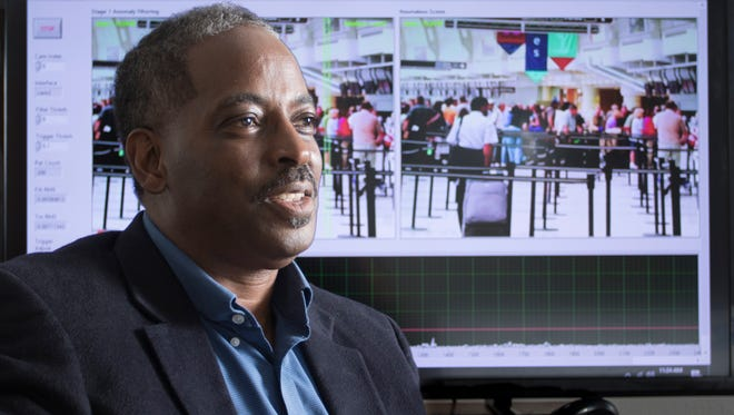 Lloyd Reshard, CEO of Cognitive Big Data Systems, poses in front of his computer vision application at his office in Pensacola on Wednesday, November 9, 2016.   This computer vision app uses creative machine learning technologies to learn the pixel patterns from a camera video stream to understand what's normal at that location and generates both threat and business intelligence information.  Cognitive Big Data Systems was selected the winner of the 2016 Get Started Pensacola event, presented by Cox Business.
