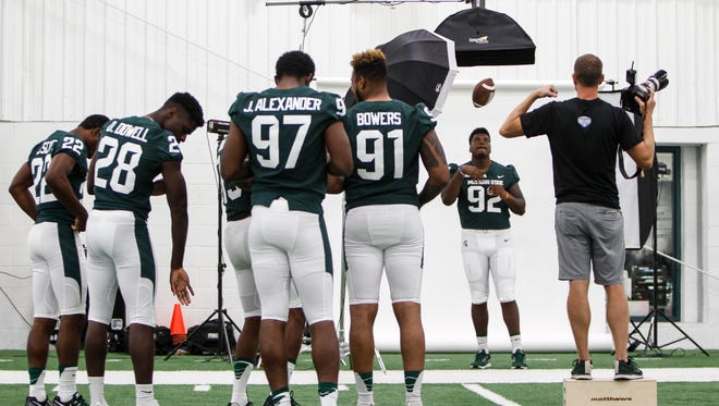 MSU gridders, including DeAri Todd, 92, get photographed Monday, Aug. 7, 2017, during media day at the Skandalaris Football Complex.  [MATTHEW DAE SMITH/Lansing State Journal]