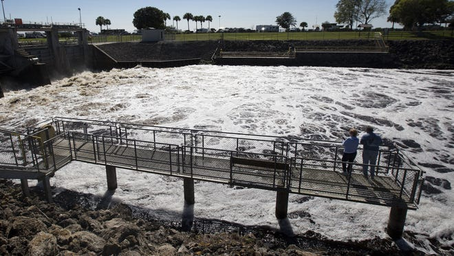 Dirty water discharged from Lake Okeechobee shoots out of the Ortona Locks along the Caloosahatchee River