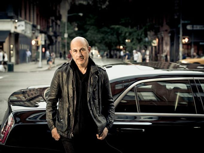 "Designer John Varvatos with namesake Chrysler 300, which brought his vision for a luxury sedan. This inspired Chrysler's designers along the way, according to automotive journalist Casey Williams. ""We're all designers,"" said Brandon Faurute, head of Chrysler Design. ""We look at fashion industry, product design, architecture; we're inspired by many different things. Fashion designers look outside of their industry as well."""