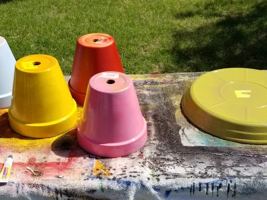 First step in making your flower pot bird bath: Paint the outside of your clay pots and pot saucer.
