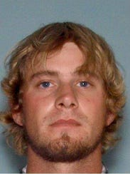 "Ronnie Adrian ""Jay"" Towns, 28, turned himself in Monday,"