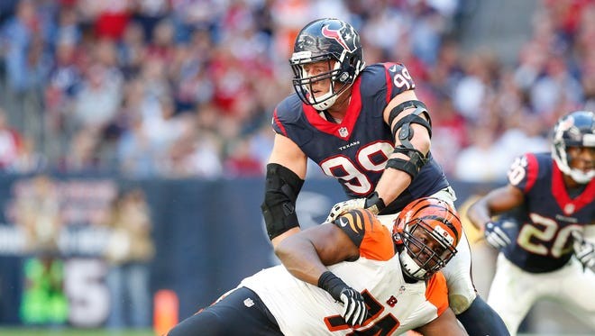 Texans defensive end J.J. Watt is blocked by Bengals tackle Marshall Newhouse.