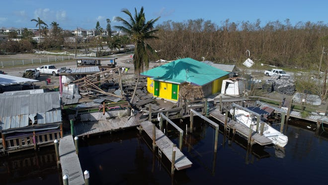 Extensive damage can be seen Tuesday, Sept. 12, 2017, after hurricane Irma passed over in the small coastal community of Goodland, Fla.