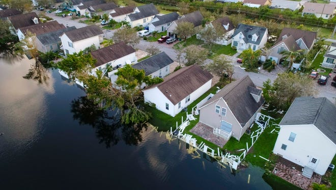Leawood Lakes homes show debris damage in East Naples Monday, Sept. 11, 2017, after Hurricane Irma passed through Southwest Florida.