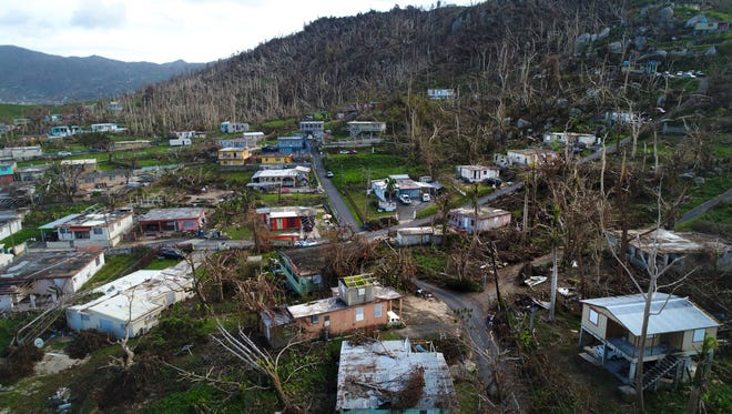Damaged homes and trees stripped of their leaves are seen throughout Yabucoa, Puerto Rico eleven days after Hurricane Maria struck the island,  Oct. 2, 2017.