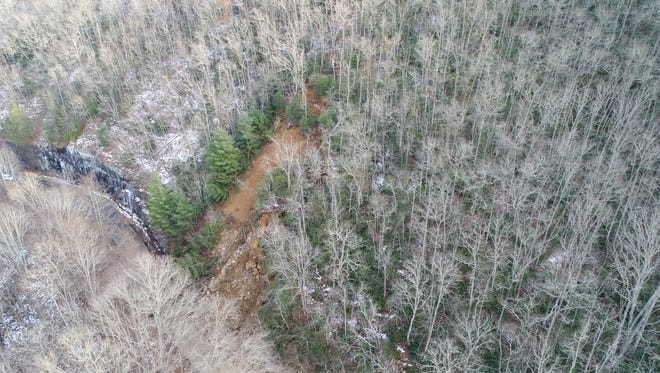 The slide area on N.C. 28 in Graham County is shown in this aerial view taken before work to clear it began. It is near a small waterfall called Rainbow Falls.