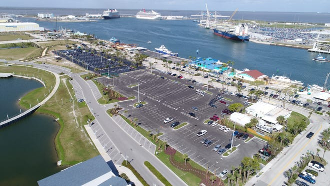 This photo shows Port Canaveral's new 337-space Cove-area parking lot, to the right, along with a resealed and restriped existing 225-space lot, to the left. The lots will serve customers and staff of the port's Cove-area restaurants and other tenants.
