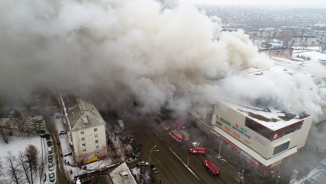 In this Russian Emergency Situations Ministry photo, on March 25, 2018, smoke rises above a multi-story shopping center in the Siberian city of Kemerovo, about 1,900 miles east of Moscow.