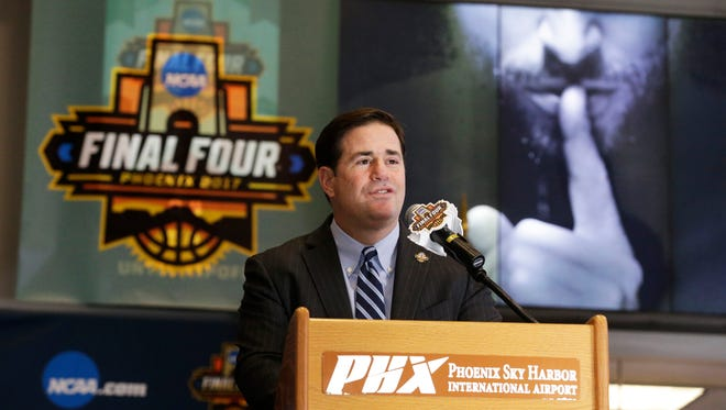 Arizona Gov. Doug Ducey appeared at the unveiling of the Final Four countdown clock in Terminal 4 at Phoenix Sky Harbor International Airport in Phoenix, Ariz., on Thursday, April 21, 2016. Next April college basketball fans will descend the Phoenix area for the 2017 NCAA Final Four.