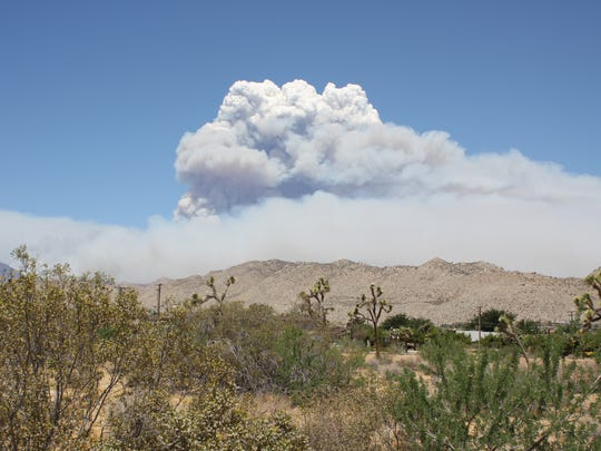 A plume of smoke formed from the Lake Fire, which has burned more than 23,000 acres in the San Bernardino Mountains. The smoke is visible in the High Desert and several communities have been evacuated.