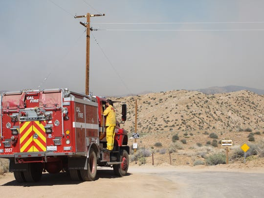Firefighters parked at the end of Burns Canyon Road in Rimrock, Thursday, where they are monitoring the Lake Fire in the San Bernardino Mountains.
