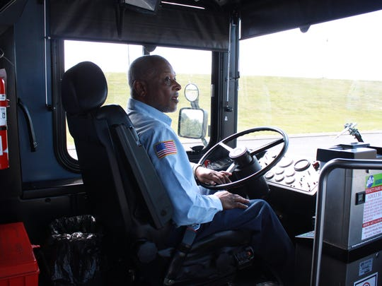 Curtis Harden drives a bus through the Jackson Transit