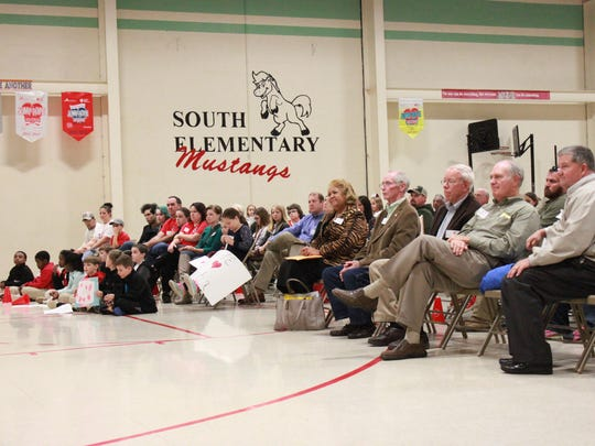 Members of the Jackson-Madison County School Board meet with supporters of South Elementary School Tuesday.