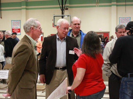 Board members George Neely, Jim Campbell and Truman Murray speak with supporters of South Elementary School at a meeting Tuesday.