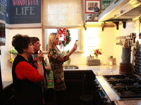 Amy Mays, Kathy McCann and Melissa Deming tour a home
