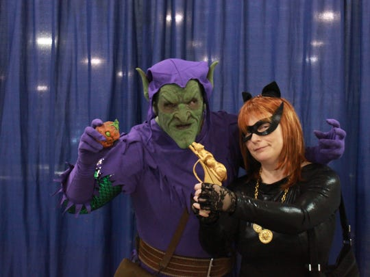 Marc and Marcy Meeker pose as the Green Goblin and Catwoman Sunday at the Southern Fried Pop Culture and Comic Con.