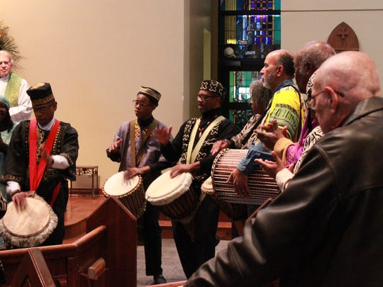 Members of the Nubian Drummers play during the Afrocentric Mass Sunday at St. Mary's Catholic Church.