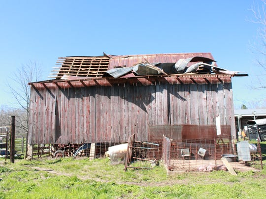 A weak tornado tore off the roof of a barn on a Benton County farm Sunday.