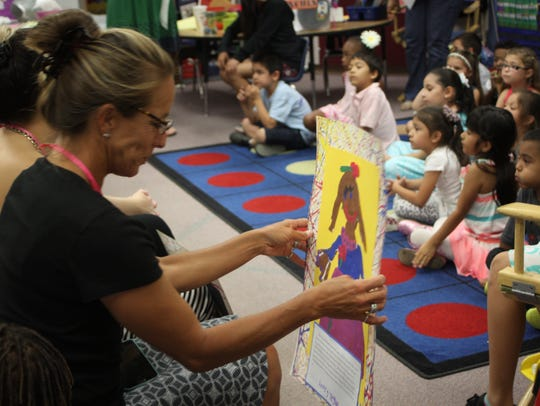 Kindergarten students in Rancho Mirage paint portraits of their moms.