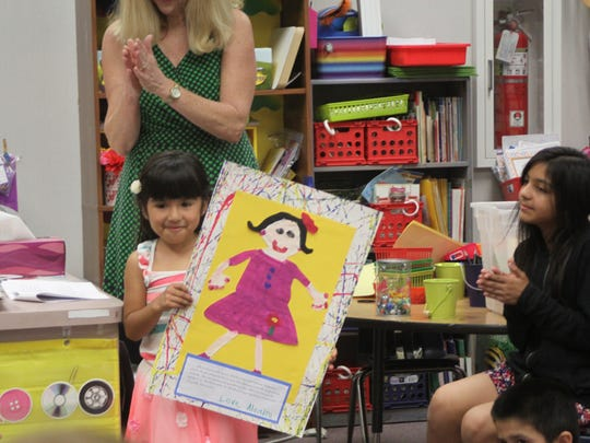 Students in Lisa Cronk's kindergarten class painted a portrait of their moms for a Mother's Day tea on May 6, 2015.