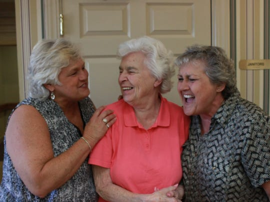 Lisa Hurd and Cindy Garside laugh with their mother Norma Hurd, center, at a Mother's Day celebration Sunday.