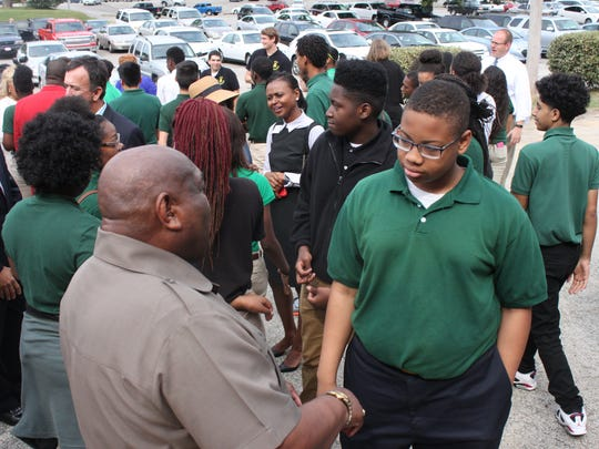 Jackson Central-Merry Early College High School students greet guests Monday at a ribbon-cutting ceremony.