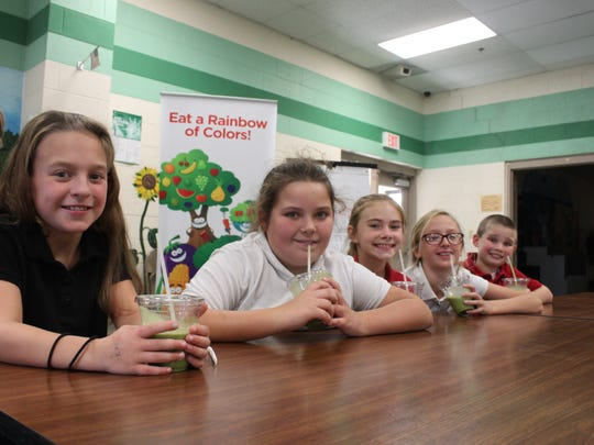 Kaylie King, Alexis Holman, Kendall Cardwell, Bailey Greer and Noah Azbill sip their fruit smoothies Monday at South Elementary School.