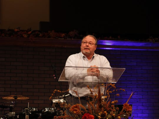 The Rev. Dale Denning speaks at Chapel Hill Baptist Church Sunday, where he celebrated 25 years as pastor.
