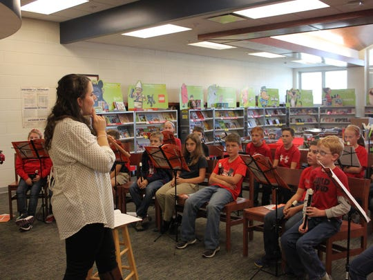 Christa Duke from the Union County Public Library begins to teach the fourth grade students of John Paul II Catholic School the beginning steps of how to play the recorder.