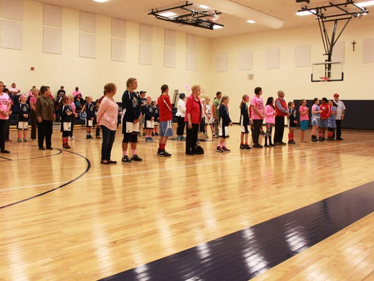 John Paul II Catholic School recently hosted their annual Pink Out basketball game.  Many cancer survivors were recognized during the half time activities.  Players from JPII and UCMS played in honor of or in memory of someone who has had cancer.
