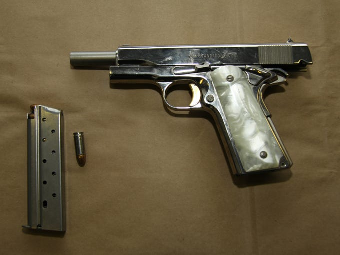 A photograph of a gun found at the home of Rebekah
