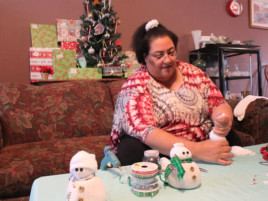 Dorothy Davis makes a sock snowman, one of her many