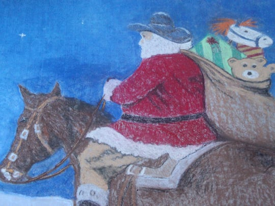Campos kept the western theme of Pioneer bank in drawing Santa Claus riding a horse into the mountains, Friday, Dec. 22 outside Pioneer Bank.