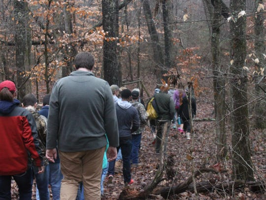 A group heads onto a trail at Chickasaw State Park.