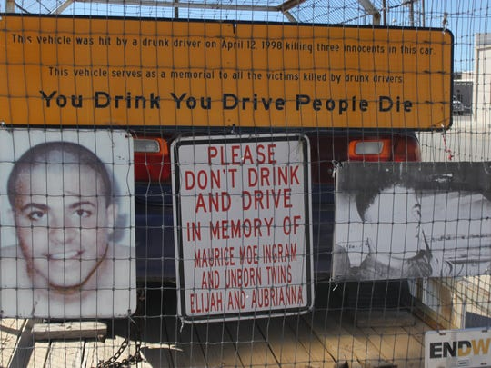 A mangled car used for educational events through the Eddy County DWI program contains images of victims of drunk driving.