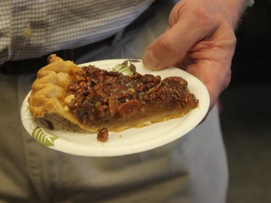 A faculty member prepares to dig into a piece of pecan pie during a Pi Day celebration, Tuesday at NMSU Carlsbad.