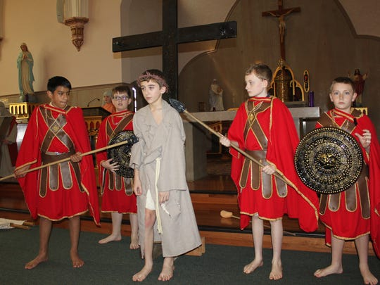 Soldiers Caden Polites, Weston Farmer, Wade Day, and Aiden Schneider prepare to crucify Jesus (Collin Nalley) during Mary's Way of the Cross on Holy Thursday.