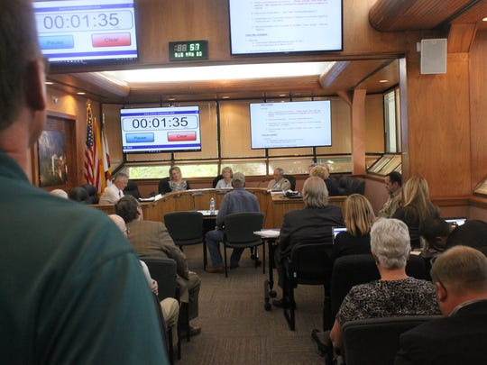 Eddy County commissioners hear from concerned citizens during a packed commission meeting Tuesday at the Eddy County Administration Building.