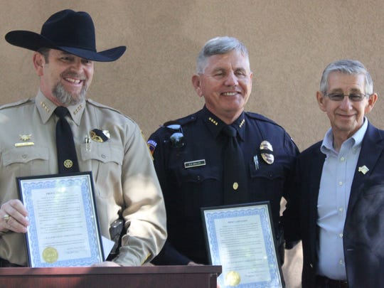 (L to R) Eddy County Sheriff Mark Cage, Carlsbad Police Chief Kent Waller and Carlsbad Mayor Dale Janway present proclamations naming May 14 to 20 Law Enforcement Appreciation Week Wednesday at the Pecos River Village Conference Center.