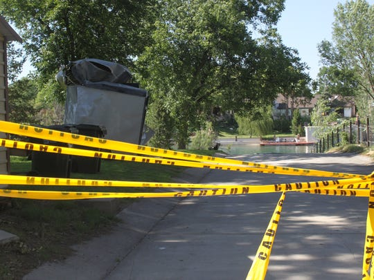 Police tape blocks off a drive way into the Pecos River after a vehicle crashed into a trailer and fell into the water Monday in the 900 block of West Riverside Drive.