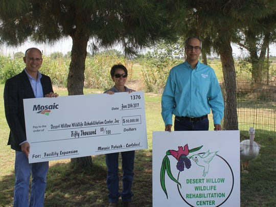(L to R) Senior VP of Potash at the Mosaic Company Bruce Bodine, Veterinarian Samantha Uhrig and Mosaic Carlsbad General Manager Paul Gill pose with the check donating $50,000 to Desert Willow Wildlife Rehabilitation Center Monday at the center.
