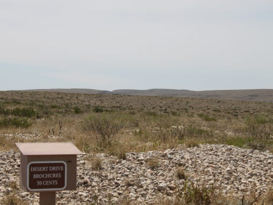 Police and rescue crews utilize the Rattlesnake Canyon trail head to search for a father and son reported missing, Tuesday at Carlsbad Caverns National Park.