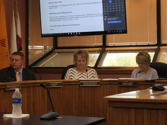 Eddy County commissioners discuss county business at a meeting.
